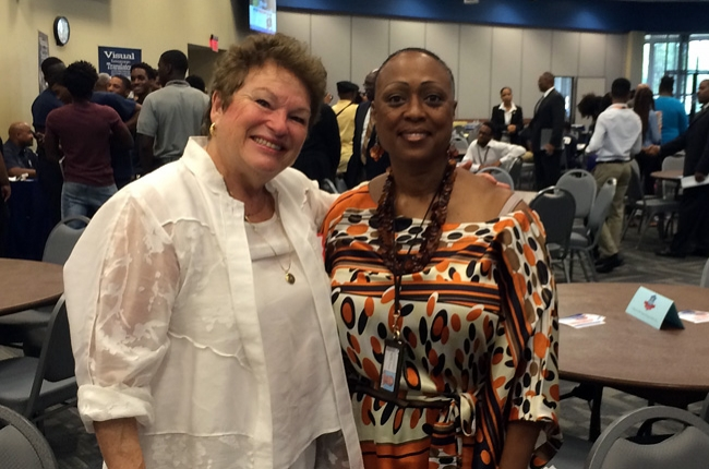 Karen Wilcox Lewis (right), Adjunct Professor and Coordinator, Administration of Justice Collegian Center (AOJCC), Public Safety and Law Department takes a photo with Dr. Ronnie Lowenstein, Advisor and Futurist to both ASTRA and the Prince George's County Public School.
